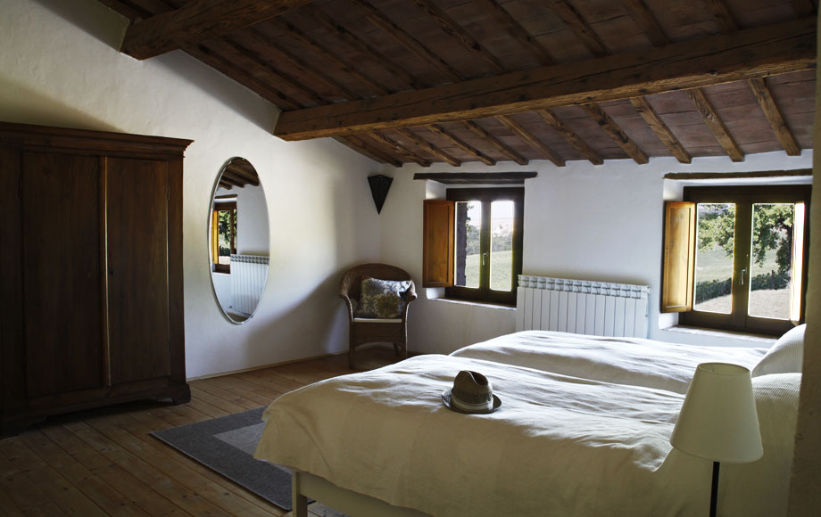 Bedroom 4 – a twin bedded room with wardrobe, chest of drawers and views over the surrounding countryside